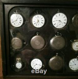24 antique silver pocket watches in Great pocket watch display case Estate as is
