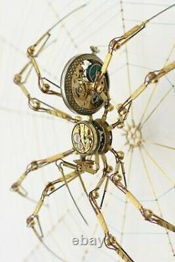 Steampunk spider sculpture made of antique pocket watch parts